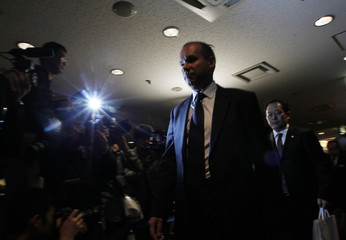 Former Olympus CEO Michael Woodford leaves after his news conference about the Olympus's scandal in Tokyo