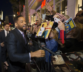 """Cast member Smith greets fans at the premiere of """"Focus"""" at the TCL Chinese theatre in Hollywood"""