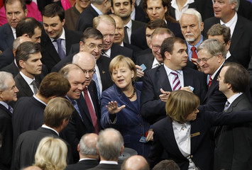 German Chancellor Merkel and members of lower house of parliament cast vote on boosting the firepower of euro zone rescue fund at Bundestag in Berlin