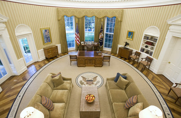 The redecorated Oval Office of Obama has new carpeting, wallpaper and sofas at the White House in Washington