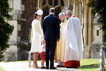 Prince George turns to look at the crowds as Princess Charlotte, Prince William and Catherine, Duchess of Cambridge are greeted by Reverend Canon Jonathan Riviere and the Archbishop of Canterbury, Justin Welby, at St Mary Magdalene