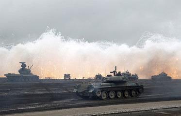 Japanese Ground Self-Defense Force armoured tanks fire during an annual training session near Mount Fuji at Higashifuji training field in Gotemba