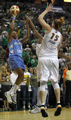Dream's Marques shoots over Storm's Jackson in their WNBA Finals Game-2 at Key Arena in Seattle