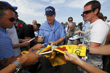 Tom Watson of the U.S. signs autographs for spectators during a practice round for the British Open golf championship at Royal St George's in Sandwich