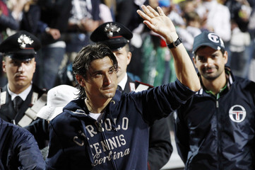 Ferrer of Spain waves at the end of the final match against his compatriot Nadal at the Rome Masters tennis tournament