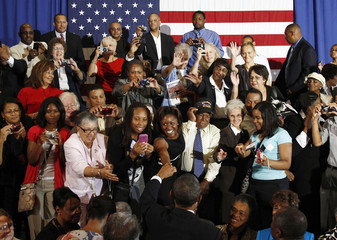 U.S. President Barack Obama greets spectators after delivering remarks at Xavier University in New Orleans, Louisiana