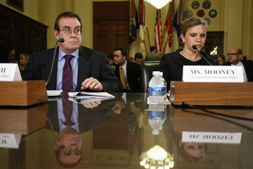 Lynch and Mooney take their seats to testify before a House VA Committee hearing on the Phoenix VA Health Care System wait list, on Capitol Hill in Washington
