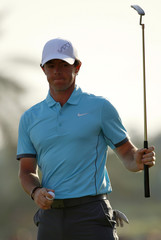 McIlroy of Northern Ireland celebrates his birdie at the 18th green during the Abu Dhabi Golf championship