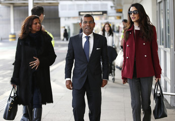 Lawyer Amal Clooney (R) walks with the deposed President of the Maldives Mohamed Nasheed and his wife Laila Ali Abdulla,after he arrived at Heathrow airport in London