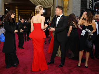 """Jennifer Lawrence, best supporting actress nominee for her role in """"American Hustle"""", talks to actor Channing Tatum at the 86th Academy Awards in Hollywood"""