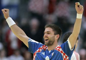 Croatia's Drago Vukovic celebrates their score during group A Men's European Handball Championship match against Russia in Graz