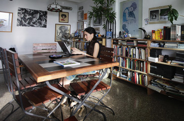 File photo of Cuban dissident blogger Yoani Sanchez working on her laptop in her home in Havana