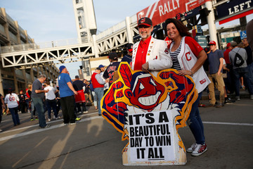 Fans of the Cleveland Indians pose for pictures outside Progressive Field before Game 6 of MLB World Series game against the Chicago Cubs in Cleveland