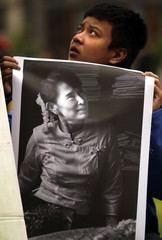 A boy holds a poster of Myanmar pro-democracy leader Aung San Suu Kyi in central Oslo