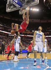 Chicago Bulls Noah dunks ball over New Orleans Hornets Anderson and Davis during second half NBA game in New Orleans, Louisiana