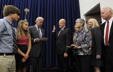 U.S. Vice President Joe Biden swears in James Clapper in Washington