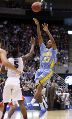Southern University guard Malcolm Miller (33) shoots over Gonzaga guard Gary Bell Jr. (5) during the first half of their second round NCAA tournament basketball game in Salt Lake City, Utah