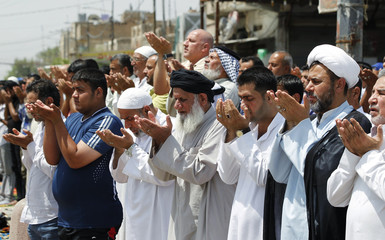 Shi'ite Muslims attend Friday prayers in Sadr City