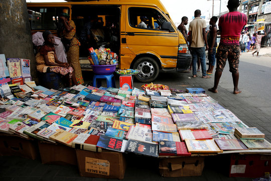 Books are displayed for sale along a road in Ikeja district in Lagos