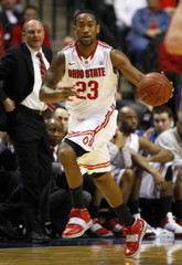 Ohio State's Lighty moves the ball against Northwestern in men's Big Ten tournament game in Indianapolis
