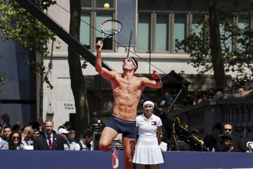 A model plays tennis during an event to promote the launch of Tommy Hilfiger's new line of underwear, in New York