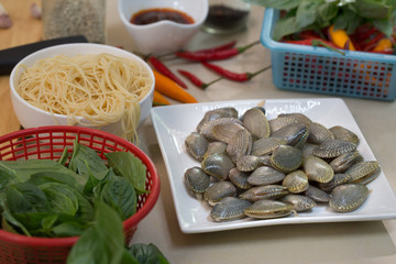 Prepare for Stir fried Clams and Spaghetti with chili paste and ingredient on table in the kitchen