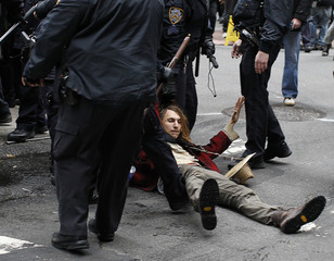 Police confront a protester during an Occupy Wall Street demonstration in New York