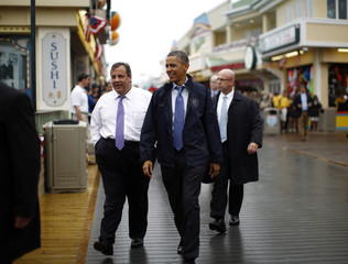 U.S. President Barack Obama and New Jersey Governor Chris Christie walk on the boardwalk at Point Pleasant in New Jersey