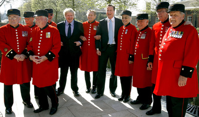 Britain's Conservative Party leader Cameron and London Mayor Johnson pose with Chelsea Pensioners during an election campaign visit in London