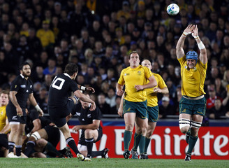Australia Wallabies captain James Horwill fails to prevent New Zealand All Blacks' Aaron Cruden from kicking a drop goal during their Rugby World Cup semi-final match at Eden Park in Auckland