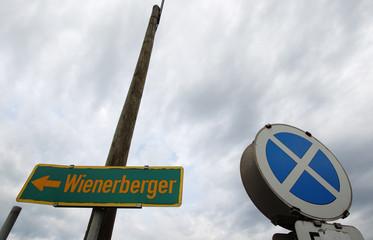 A road sign leads to the headquarters of Wienerberger the world's biggest brickmaker in Hennersdorf