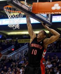 Toronto Raptors DeMar DeRozan dunks the ball against the Phoenix Suns in their NBA basketball game in Phoenix