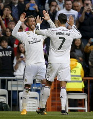 Real Madrid's Sergio Ramos celebrates his goal against Malaga with his teammate Cristiano Ronaldo during their Spanish First Division soccer match at Santiago Bernabeu stadium in Madrid