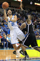Hornets point guard Vasquez shoots over Nets point guard Watson during the first half of their NBA basketball game in New Orleans