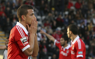 Benfica's Rodrigo Lima reacts during their Portuguese Premier League soccer match against Nacional held at Choupana stadium in Funchal