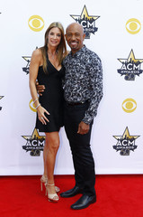 Montel Williams and his wife arrive at the 50th Annual Academy of Country Music Awards in Arlington