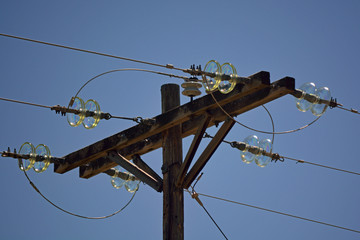 Wooden Power Pole with Antique Glass Insulators on a Sunny Day