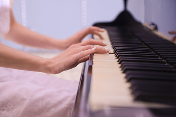 Female hands playing piano
