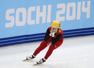 Winner China's Zhou Yang reacts after the women's 1,500 metres short track speed skating finals race at the Iceberg Skating Palace at the Sochi 2014 Winter Olympic Games