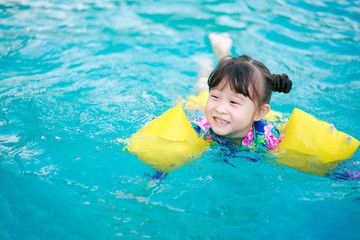 Asian little girl in swimming pool
