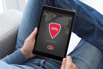 man holding tablet app vpn creation Internet protocols protection network