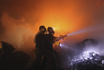 Palestinians extinguish fire from a medicine storage facility  in the northern Gaza Strip