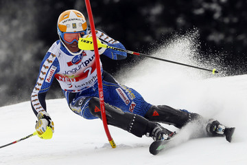 Myhrer of Sweden clears a pole during the season's last slalom race at the Alpine Skiing World Cup finals in Lenzerheide