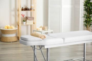 Interior of massage room in modern wellness center