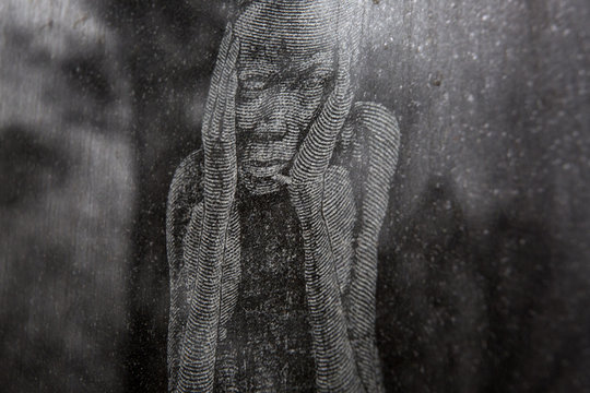 An etching on a memorial wall depicts a suffering slave at the Whitney Plantation in Wallace Louisiana