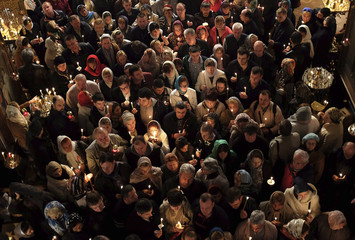 Russian Christian Orthodox worshippers hold candles during a holy Easter service at the Church of St. Peter and Paul in Karlovy Vary