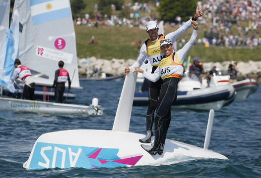 Australia's Mathew Belcher and Malcolm Page celebrate as they cross the finish line to win gold in the men's 470 sailing class during the medal race at the London 2012 Olympic Games in Weymouth and Portland