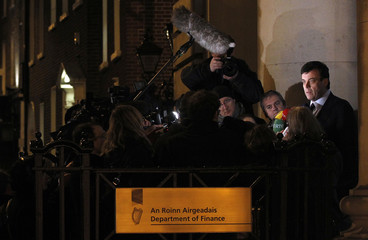 Ireland's Finance Minster, Brian Lenihan, speaks to the media as he leaves the Department of Finance in Dublin