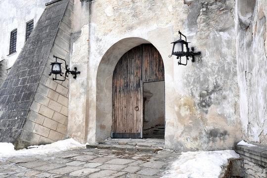 Doors in courtyard of old house in winter