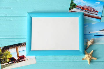 Travel concept. Color frame with space for text and cute decorations on wooden background